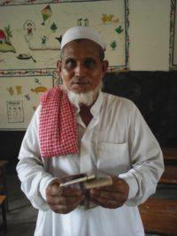 man holding money in bangladesh