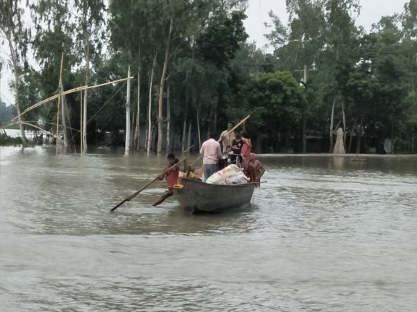 people trying to escape from their flooding home in bangladesh