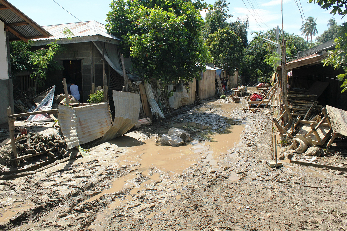 Destroyed houses and flooded street in uganda