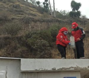 Ecuador Red Cross volunteers monitoring the ashfall with ashfall meters